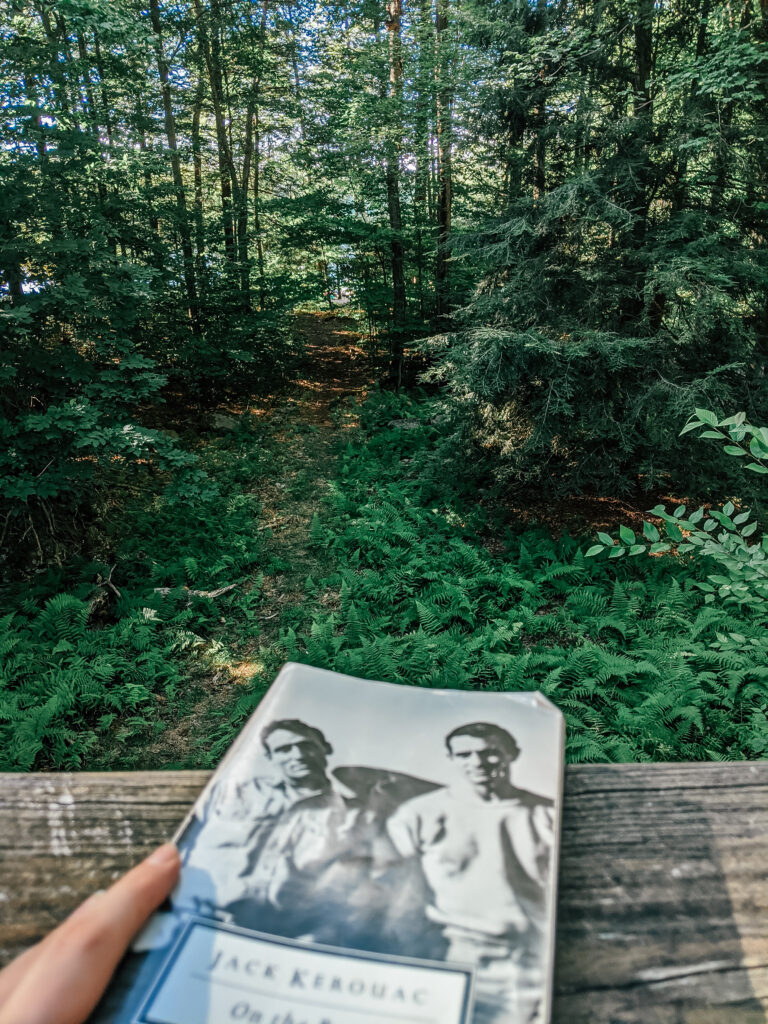 Image of book (Jack Kerouac's On The Road) in the Pocono Pines woods