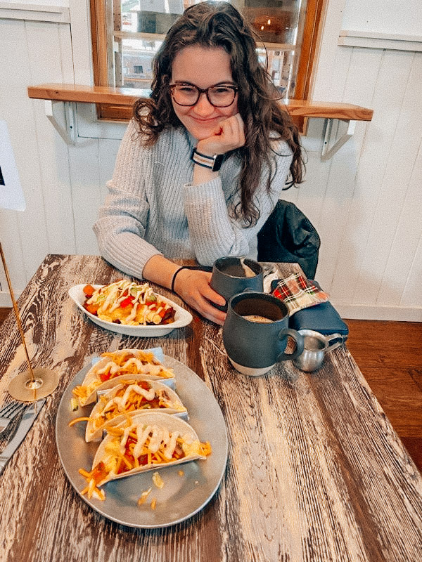 Photo of Moira, the blogger at Moira The Explorer, with breakfast at the Union Market, a women run cafe in the LBI Region