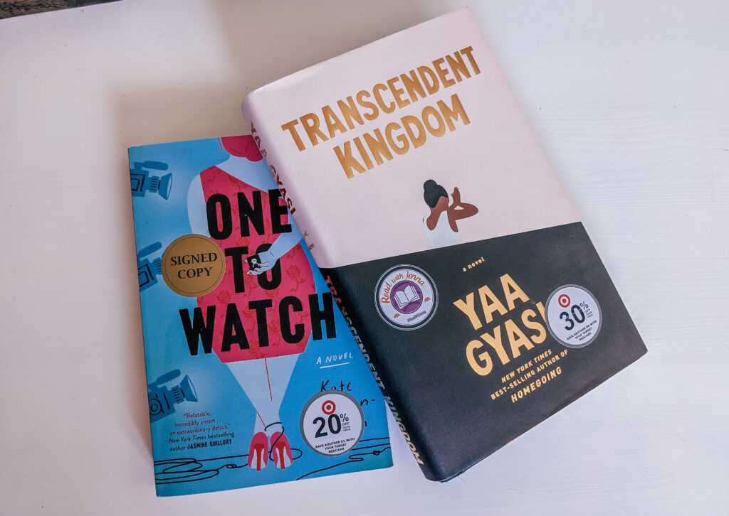 Summer Reading books One to Watch by Kate Stayman-London and Transcendent Kingdom by Yaa Gyasi placed on a smooth, white wood table.